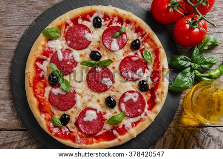 pizza with salami tomato and cheese