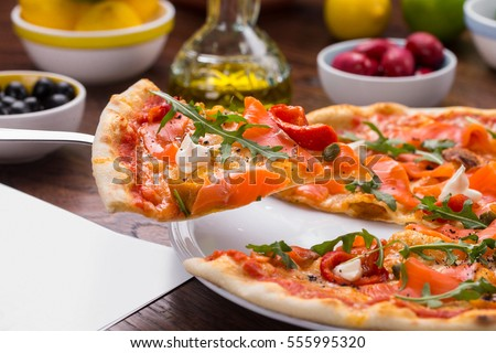 Pizza with salmon.