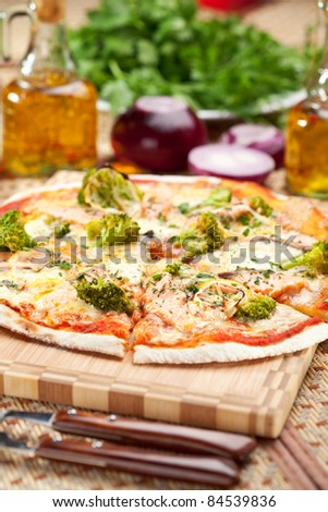 Pizza with Salmon, Broccoli, Cheese and Lemon - stock photo