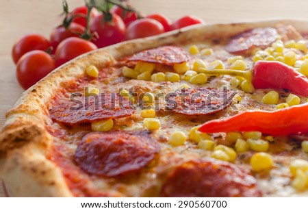 Pizza with sausage, corn and and pepperoni - Close up - stock photo