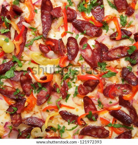 Pizza with sausage hunting as a food background or texture.