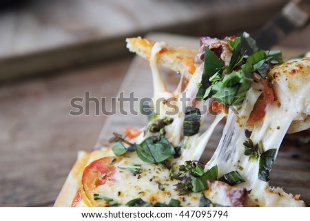 pizza with seafood and tomatoes on a wooden table , italian food - stock photo