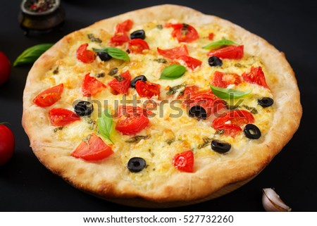 Pizza with tomato, mozzarella, basil and olives