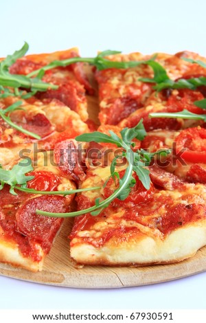 Pizza with tomatoes and herbs