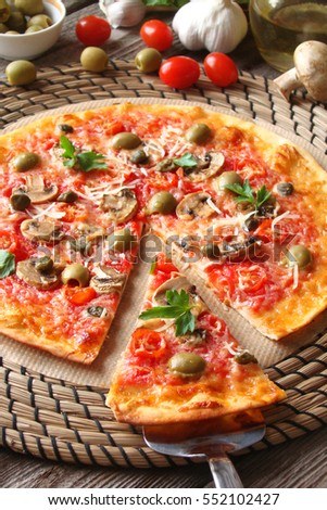 Pizza with tomatoes, mushrooms, black olives, Parmesan cheese, capers and tomato sauce