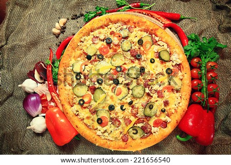 pizza with vegetables and herbs rustic background - stock photo