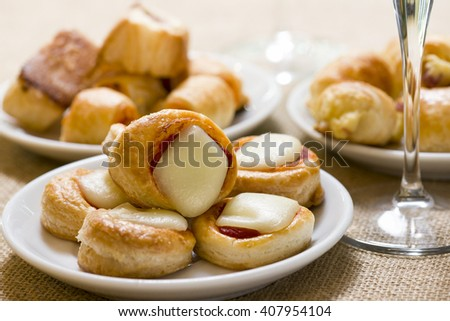 pizzette and other appetizers on plate - stock photo