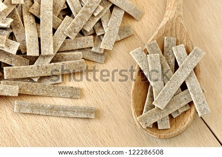 Pizzoccheri on a wooden chopping board, italian pasta, specialty of Valtellina, Italy