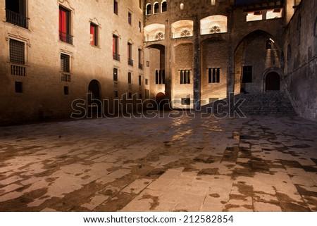 Placa del Rei (Plaza del Rey, King's Square) at night in Barri Gotic (Gothic Quarter) of Barcelona, Catalonia, Spain. - stock photo