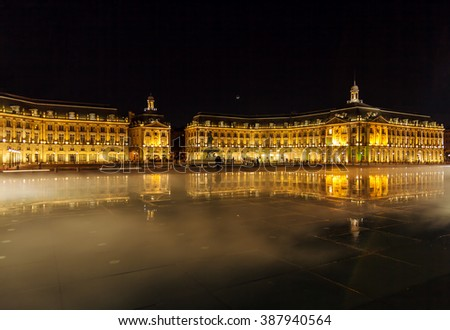 Place de la Bourse (1745-1747, designed by Jacques-Ange Gabriel) and water mirror at night, Bordeaux, France