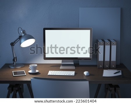 place of work with computer monitor at night - stock photo