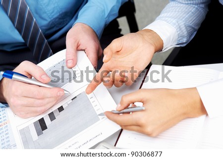 Place of work with papers and documents and hands of people working with them