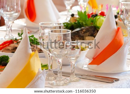 place setting at a laid restaurant banquet table - stock photo
