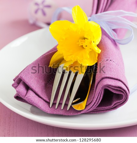 place setting for easter with daffodil - stock photo