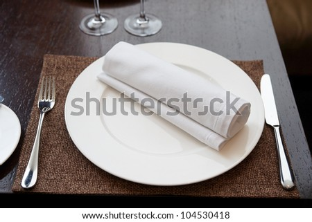 Place setting in expensive restaurant - stock photo