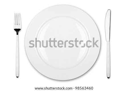 place setting with dish fork and knife - stock photo