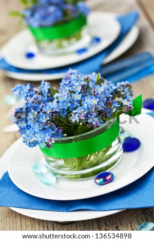 Place Setting with Forgetmenot Flowers - stock photo