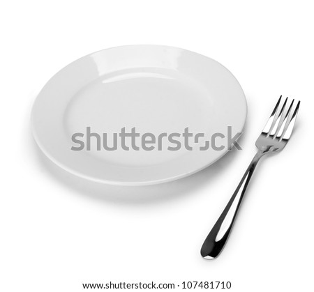 Place setting with plate and fork - stock photo