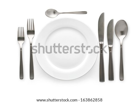 Place setting with plate, knife and fork. on white background - stock photo