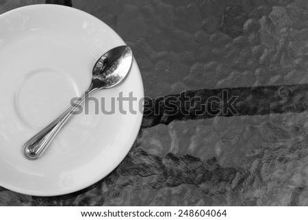 Place setting with plate spoons - stock photo