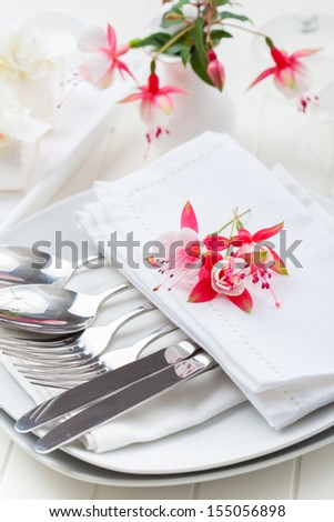 Place setting with small flowers - stock photo