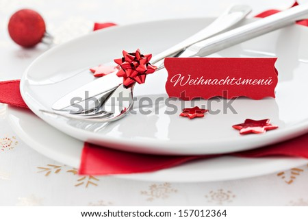 place setting with tag and german text weihnachtsmenue - stock photo