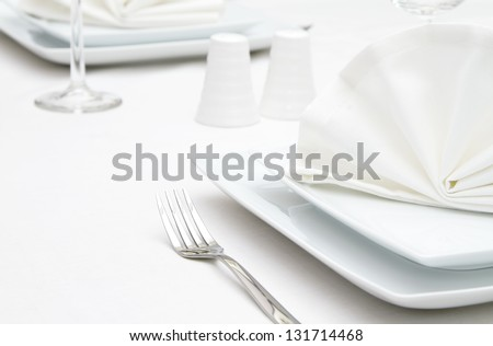 Place settings with white plates - stock photo