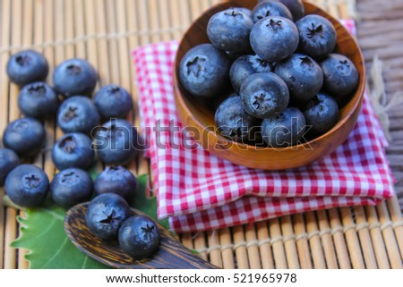 Place the blueberries in a vast wooden floor.