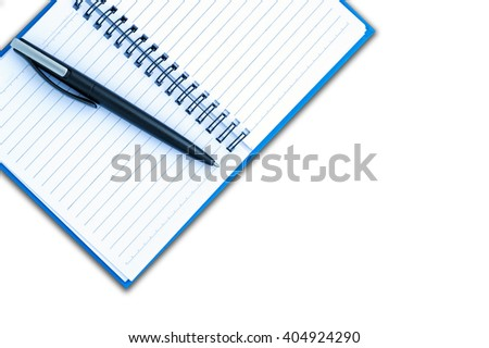 Place the pen on a blank page of a notebook on white background. - stock photo