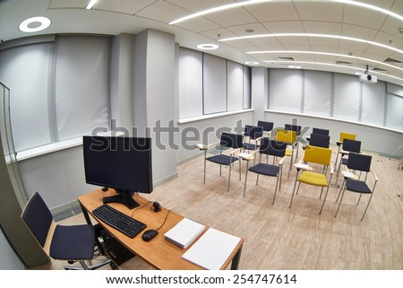 Place the teacher and empty classroom with ���hairs and notepads. Fish-eye photo - stock photo