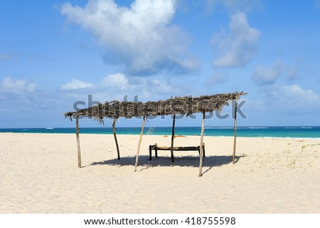 Place to hiding in the shadows of the burning tropical sun on a beach - stock photo
