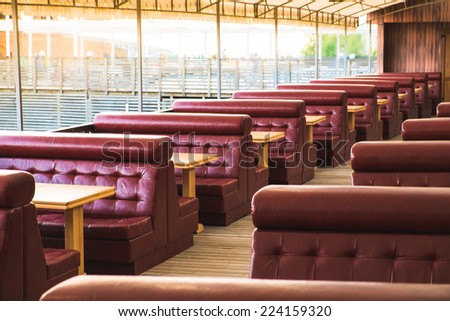 place to relax, sofas and tables in restaurant - stock photo