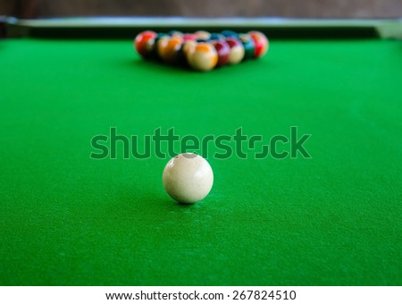 Placement of billiard balls on the table before the game. Focus on the white ball - stock photo