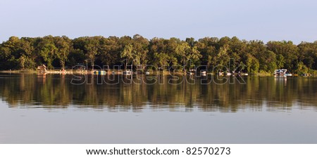 Placid Morning Lake Surrounding Minnesota Island Shoreline Panorama - stock photo