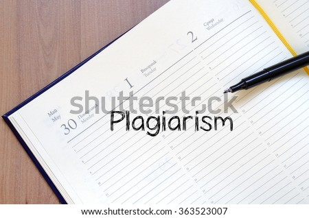 Plagiarism text concept write on notebook with pen