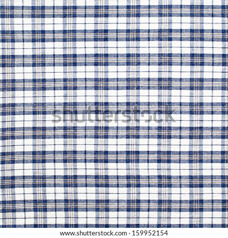 Plaid fabric as a background - stock photo