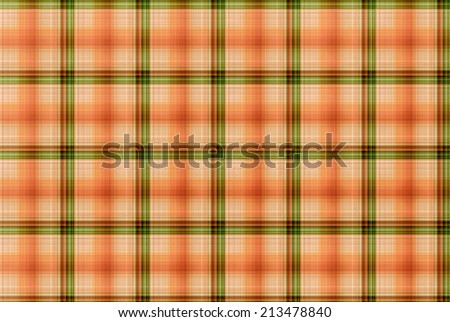 Plaid is a pattern consisting of crossed horizontal and vertical bands in two or more colors in woven cloth. - stock photo