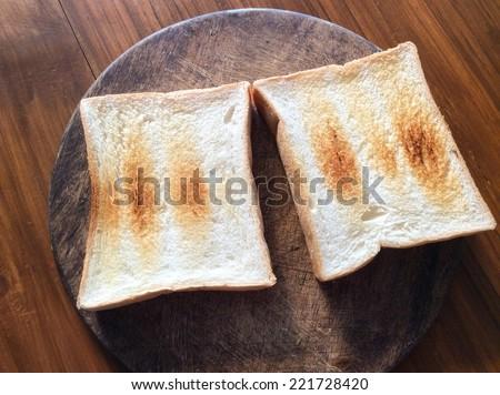 Plain Bread Toast on wooden desk - stock photo