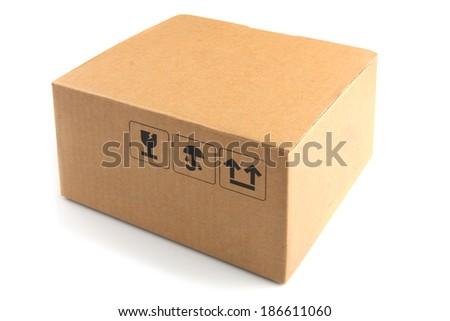 Plain cardboard box on white background  - stock photo