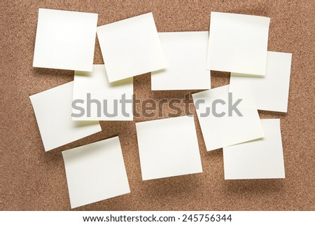 plain cork pin board with post it notes stuck to it - stock photo