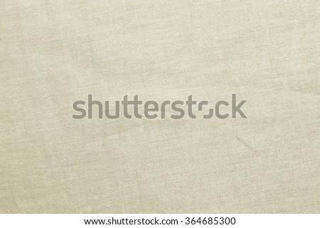 plain flat bright tan color harsh fabric textile texture background:detail of plain burlap backdrop:rustic seamless pattern canvas structure clothing concept:beige color of linen wallpaper picture - stock photo