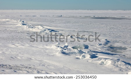 Plain of snow, ice, lake