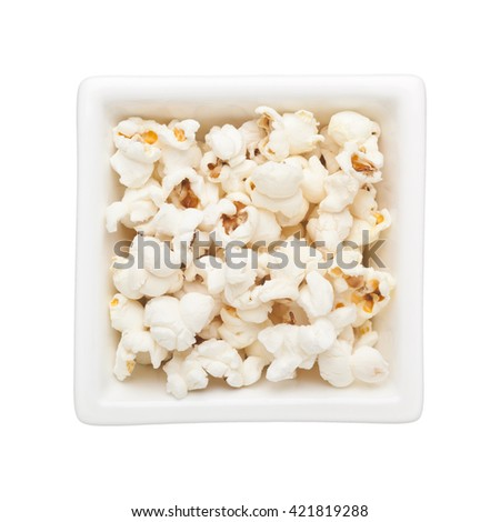 Plain popcorn in a square bowl isolated on white background - stock photo
