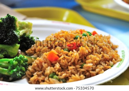 Plain vegetable fried rice and healthy green vegetables. - stock photo