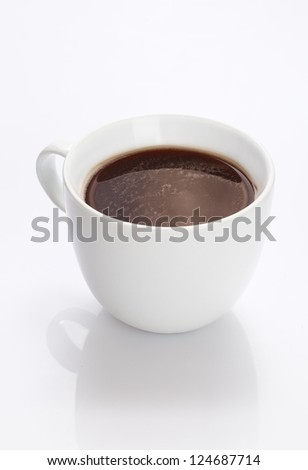 Plain white china cup of hot fresh strong black coffee on a white background with reflection - stock photo