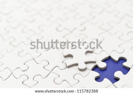 Plain white jigsaw puzzle. (Mount in dark blue) - stock photo