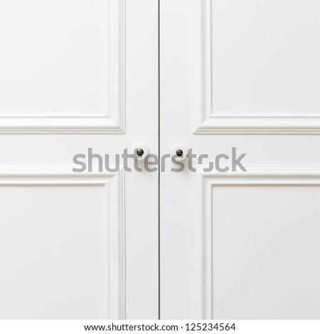 Plain white wooden doors - stock photo