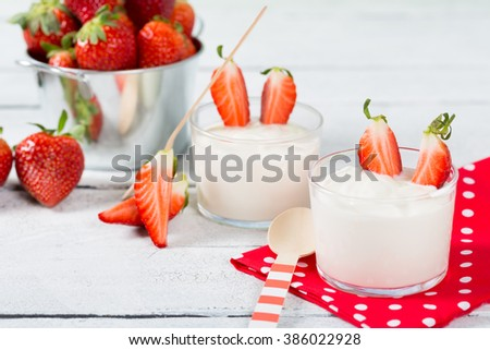 Plain yogurt with delicious fresh strawberries - stock photo