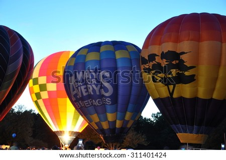PLAINVILLE, CT - AUG 28: Balloon Glow at Dusk at the 2015 Plainville Fire Company Hot Air Balloon Festival held from August 28-30, 2015. Thousands of people attended this festival in its 31st year. - stock photo