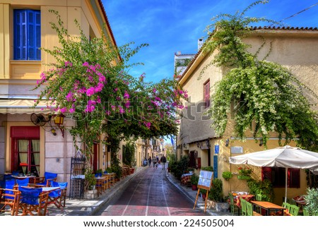 "Plaka,an old historical neighbourhood of Athens, clustered around the northern and eastern slopes of the Acropolis,known as the ""Neighbourhood of the Gods""  - stock photo"